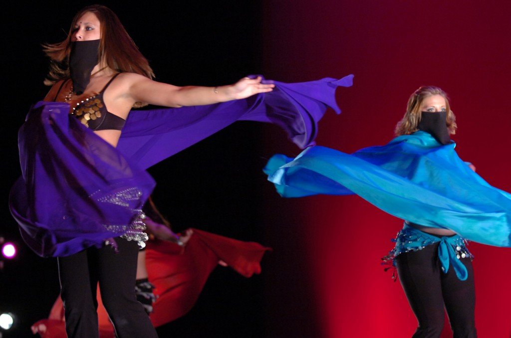 Lacey Gillespie (left) and Sasha Misan perform a belly dance during the International Dance Festival on Saturday at the University of Maine's Collins Center for the Arts in Orono. The annual event was organized by the International Student Association and put on with the help of more than 100 dancers and crew members.