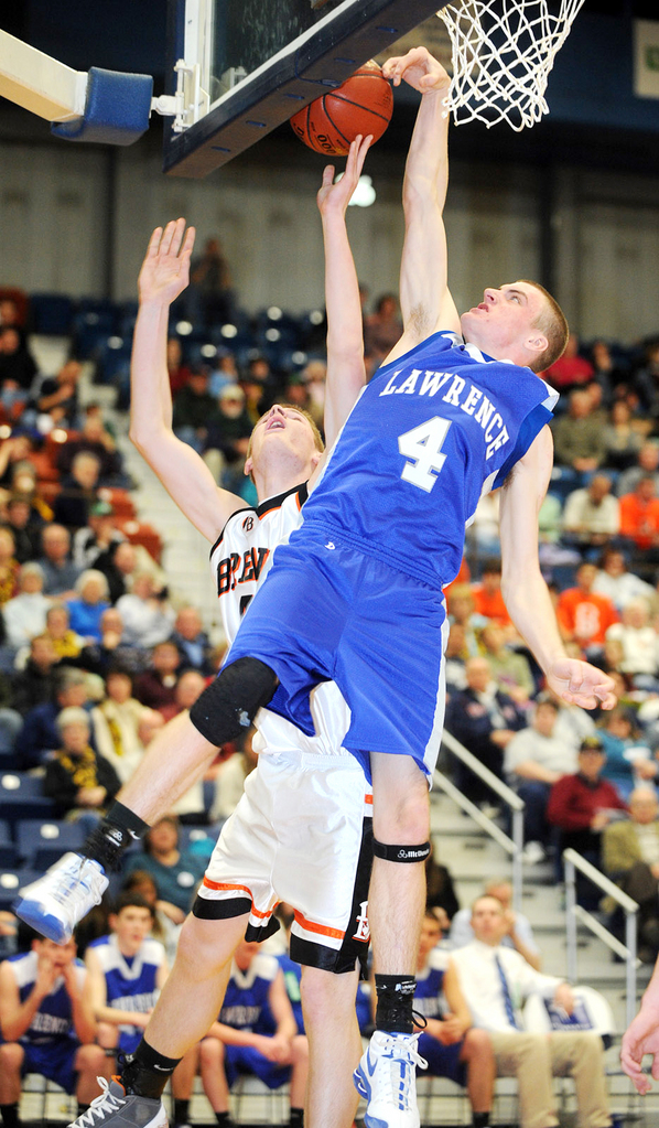 Lawrence High School's Brooks Spaulding (right) blocks a shot by Brewer High School's Nate Carson during the first half of the game Saturday evening at the Augusta Civic Center. Lawrence won 42-40. Buy Photo