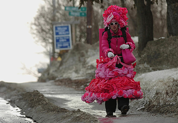 University of Maine Farmington student Tim Berry makes his way down Orono's Main Street on Wednesday dressed in drag as part of a performance art and fundraising project. He left Gorham on Feb. 12 and hopes to finish his 312-mile walk in Presque Isle late next week.  Buy Photo