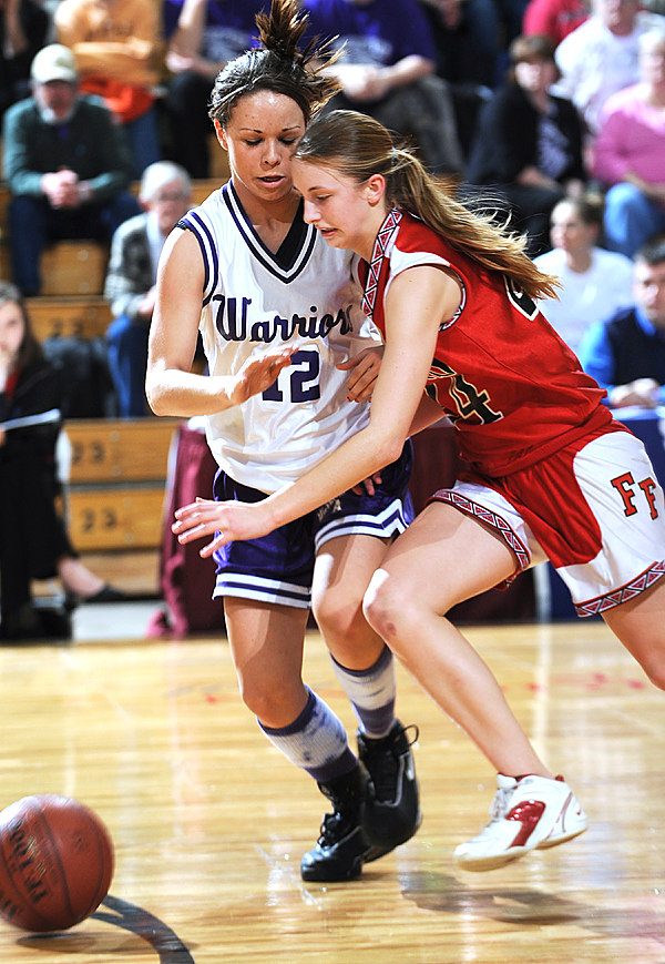 Fort Fairfield's Courtney Churchill, right, drives past Southern Aroostook Community School defender, Rochelle Nadeau, left on Thursday, Feb. 19, 2009 during 2nd half action at the Bangor Auditorium.  Buy Photo