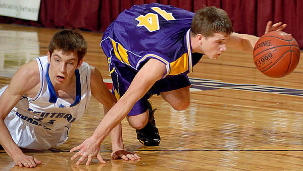 Central Aroostook's Logan McLaughlin fouls Woodland's Chad James in second half action of the boys class D Eastern Maine Championship game Saturday morning at the Bangor Auditorium. Buy Photo