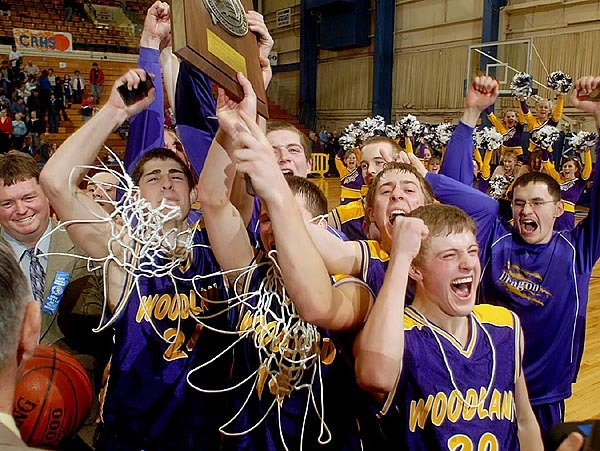 The Woodland Dragons celebrate their 48-36 victory over the Central Aroostook Panthers in the class D Eastern Maine Championship game Saturday morning at the Bangor Auditorium. Buy Photo