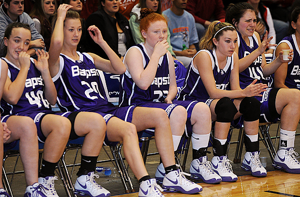 John Bapst High School's players on the bench react as a teammate fails to score during the Eastern Maine Class B championship game agains Waterville High School.   Buy Photo