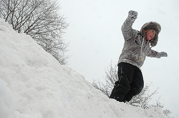 Nick Fournier, 5, of Bangor readies to leap from a snowbank while enjoying a day off from school due to a storm Monday.