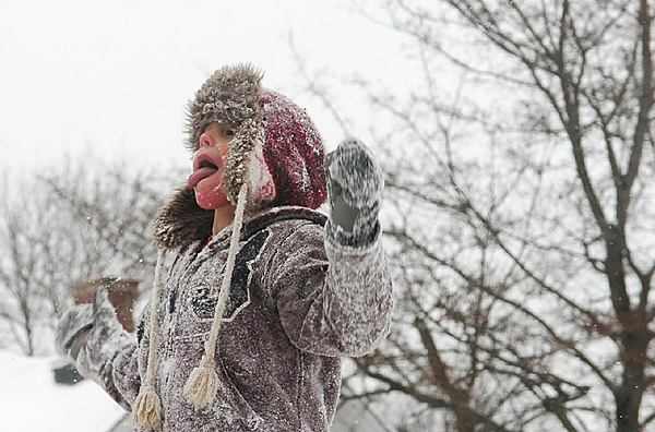 Nick Fournier, 5, of Bangor catches snowflakes on his tongue while enjoying a day off from school due to the storm Monday.
