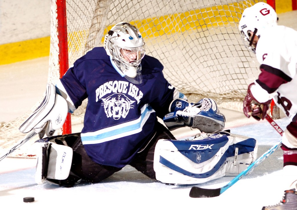 Presque Isle goalie Josh MacFarline blocks an attempted goal during the second period of the Wildcats' Class B state ice hockey championship against Greely on Saturday at the Colisee  in Lewiston. Greely captured the title with a final score of 5-1.  Buy Photo