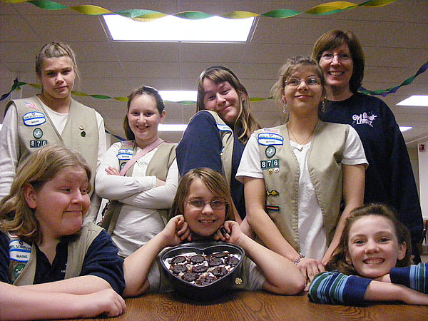 The Girl Scouts from Troop 861, along with troop leader Stephanie Fournier (upper right), pose with their cookie creation, Thin Mint Pie, at their meeting last week.