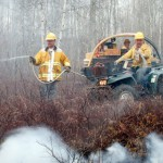Woods fire contained, still burning