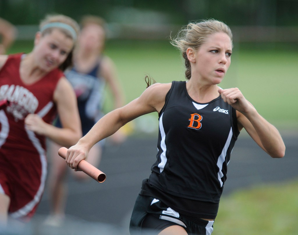 Brewer High School's Rylee Hutchins gets the baton and runs for her section of teh girl's 4x100 relay Saturday at Cameron Stadium in Bangor.