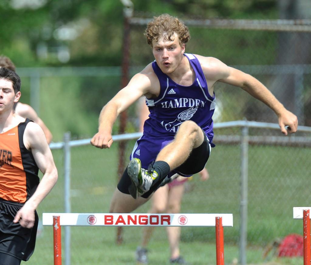 Hampden's Matt Toothaker sails over a hurdle Saturday at Cameron Stadium in Bangor.