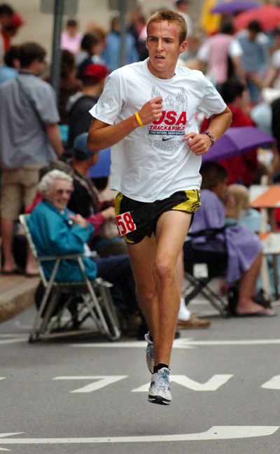Riley Masters of Bangor runs up State Street during the Fourth of July 3K in Bangor on Saturday morning, July 4, 2009. Masters won the race in 8:16 but was unable to break the course record  of 8:10 set by Tim Wakeland in 1987.  Buy Photo