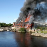 Fire destroys old woolen mill in Oakland