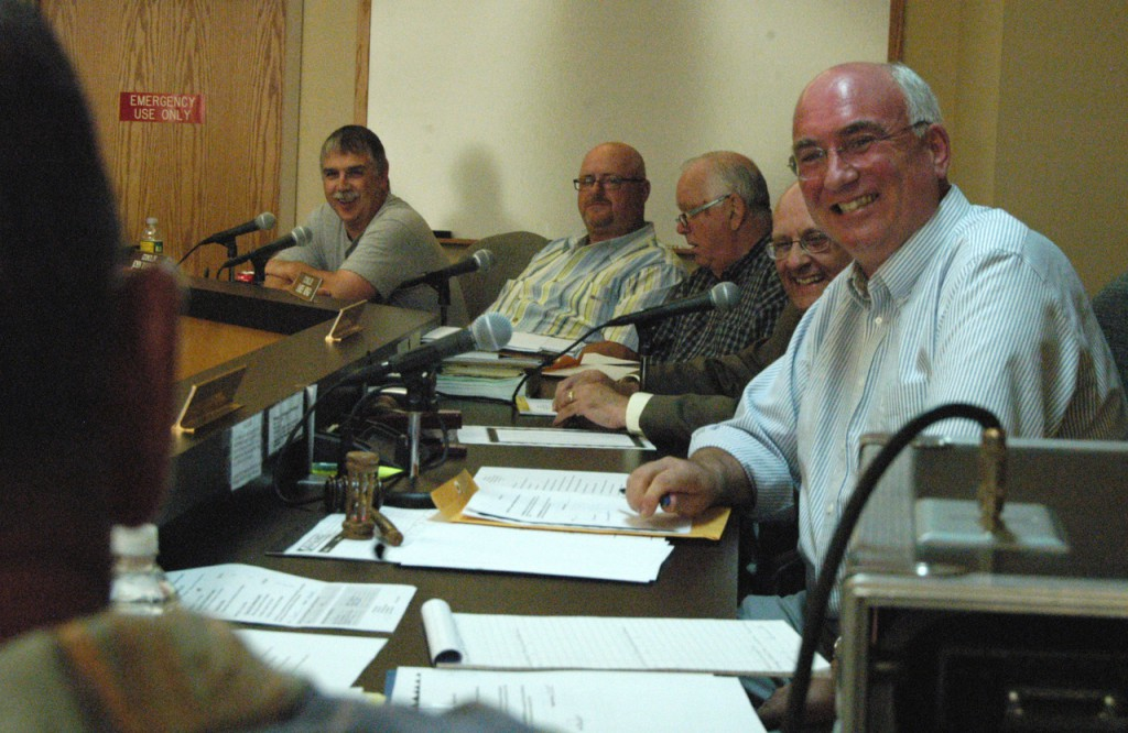 BANGOR DAILY NEWS PHOTO BY NICK SAMBIDES JR.  Millinocket Town Council Chairman Wallace Paul laughs as Councilor Scott Gonya teases and praises him during a council meeting on Thursday. Paul resigns the council effective today to take a job in Massachusetts.