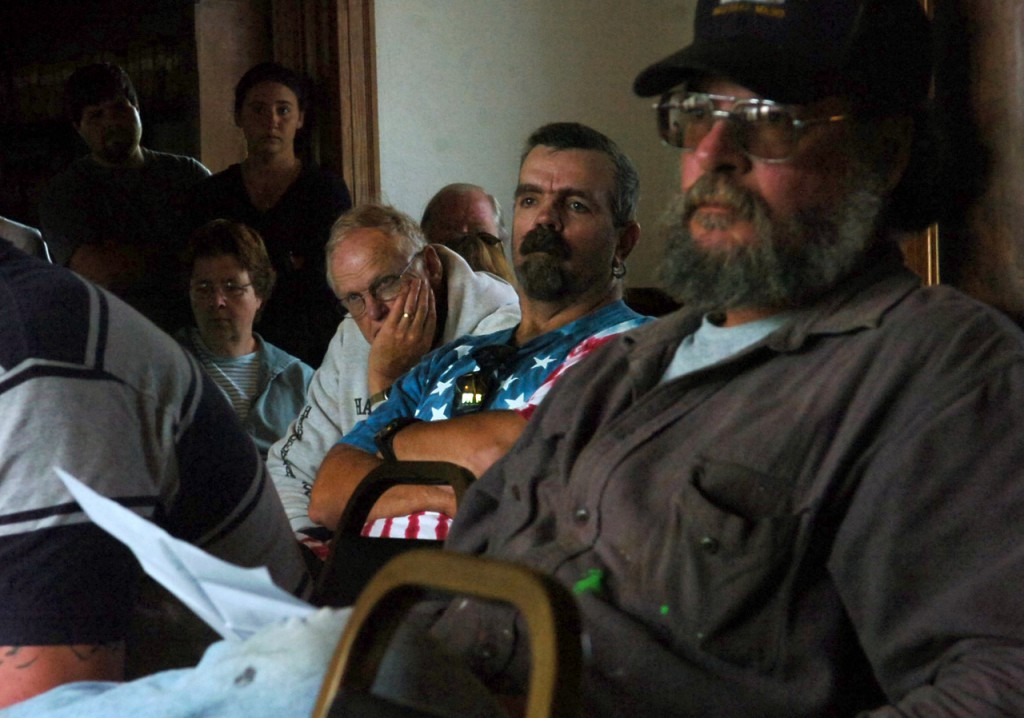 Lobstermen and members of the Matinicus community listen during an open public meeting with representatives of the Department of Marine Resources and law enforcement officials held on Saturday, July 25, 2009.  The meeting was held to addresses the recent shooting of lobsterman Chris Young by fellow lobsterman Vance Bunker over fishing territory and the subsequent temporary ban imposed upon all the lobsterman, which was then overturned.