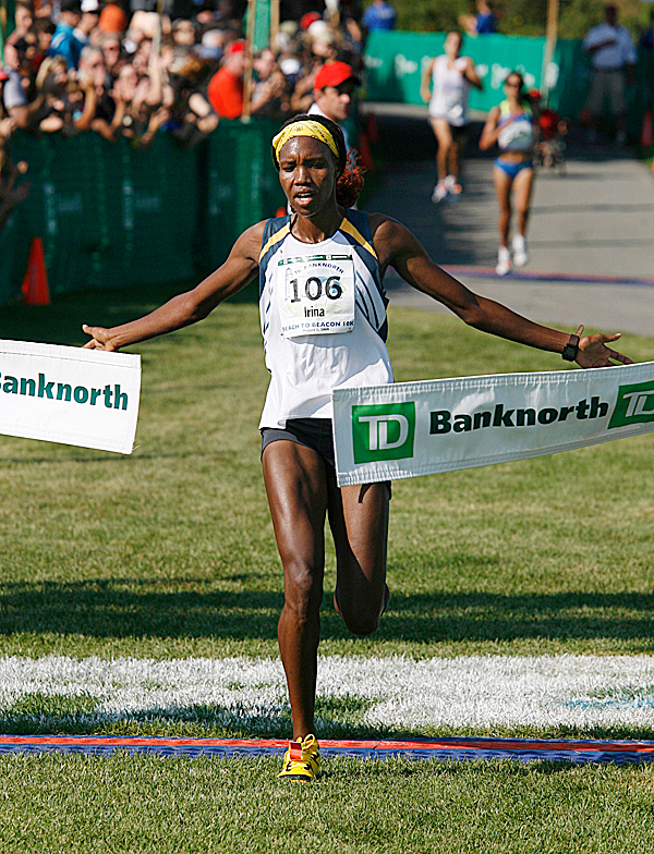 Irene Limika, of Kenya,  crosses the finish line to win the the Beach To Beacon 10-kilometer road race Saturday, Aug. 1, 2009 in Cape Elizabeth, Maine. (AP Photo/Joel Page)