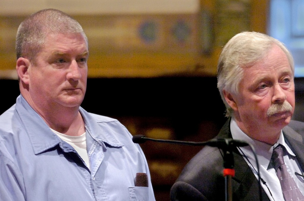 Thomas Mitchell (left) and his attorney Jim Strong appear in Kennebec County Superior Court on Thursday in Augusta for an arraignment hearing in connection with the Jan. 6, 1983, murder of Judith Flagg that occurred in Fayette. (AP Photo/Kennebec Journal, Joe Phelan) ** MAGS OUT **