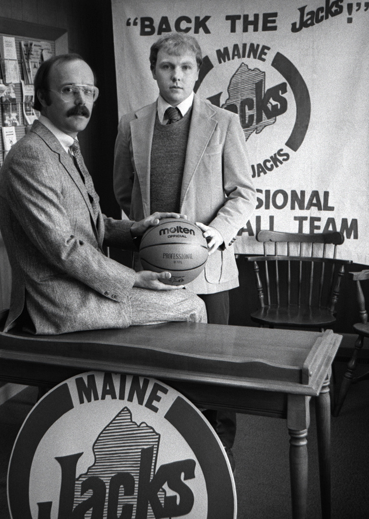 Coach Ron Brown, elft, and assistant coach Jim  Sleeper of the Maine Lumberjacks pose in a Sept. 25, 1980 file photo at the team's headquarters at the Maine Publicity Bureau on Main Street in Bangor.  (Bangor Daily News/files)