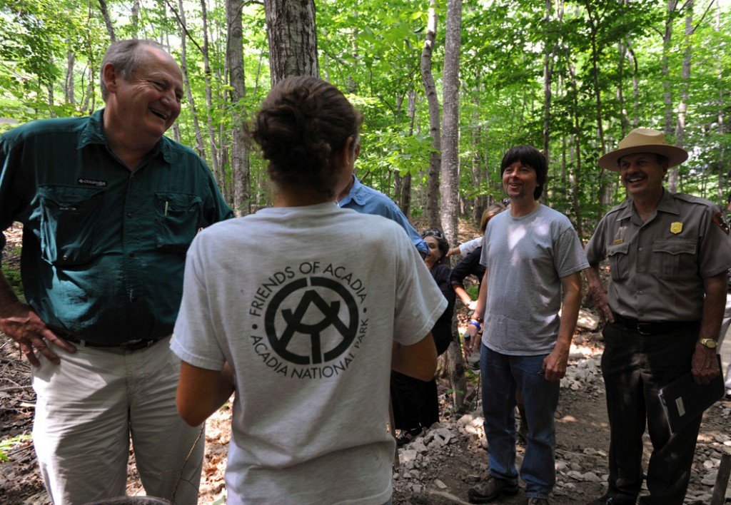 (BANGOR DAILY NEWS PHOTO BY KEVIN BENNETT)  CAPTION  Producer Dayton Duncan, left , documentary film-maker, Ken Burns, second from right and Acadia National Park Superintendent Sheridan Steele meet with Acadia Youth Conservation Corps trail worker Anna Coplan, center,of Somesville, as Burns tours Acadia National Park on Wednesday, August 15, 2009. (Bangor Daily News photo by Kevin Bennett)