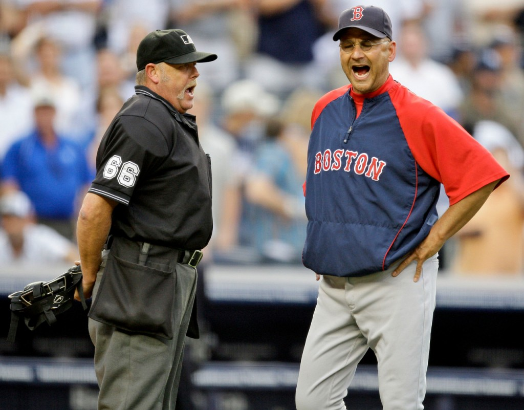 Boston Red Sox Manager Terry Francona, right, argues with home plate umpire Jim Joyce, left after relief pitcher Ramon Ramirez is ejected after New York Yankees' Alex Rodriguez is hit with a pitch and during the seventh inning of a baseball game Saturday, Aug. 8, 2009,  in New York.  (AP Photo/Frank Franklin II)
