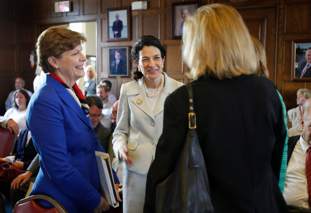 Sen. Jeanne Shaheen, D-N.H., left, joined by Sen. Olympia Snowe, R-Maine, center, speak with Small Business Administration Regional Administrator Jeanne Hulit, right, Wednesday, Aug. 12, 2009 before the start of a &quotSmall Business Field Hearing&quot in Portland, Maine. Snowe is Ranking Member of the U.S. Senate Committee on Small Business and Entrepreneurship of which Shaheen  is also a member. (AP Photo/Joel Page)