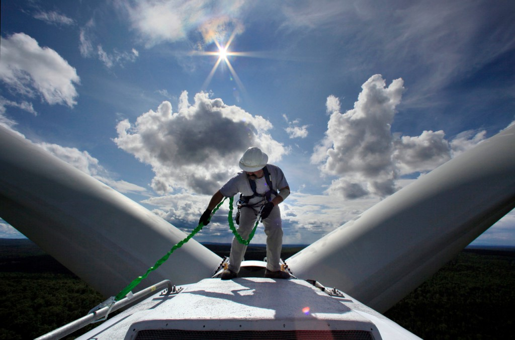 Maritime skills aid windmill workers  Mike Cianchette, operations manager of the Stetson Mountain wind project, checks his safety line before making inspections on top of a 300-foot-tall windmill in Township 8, Range 3 recently.