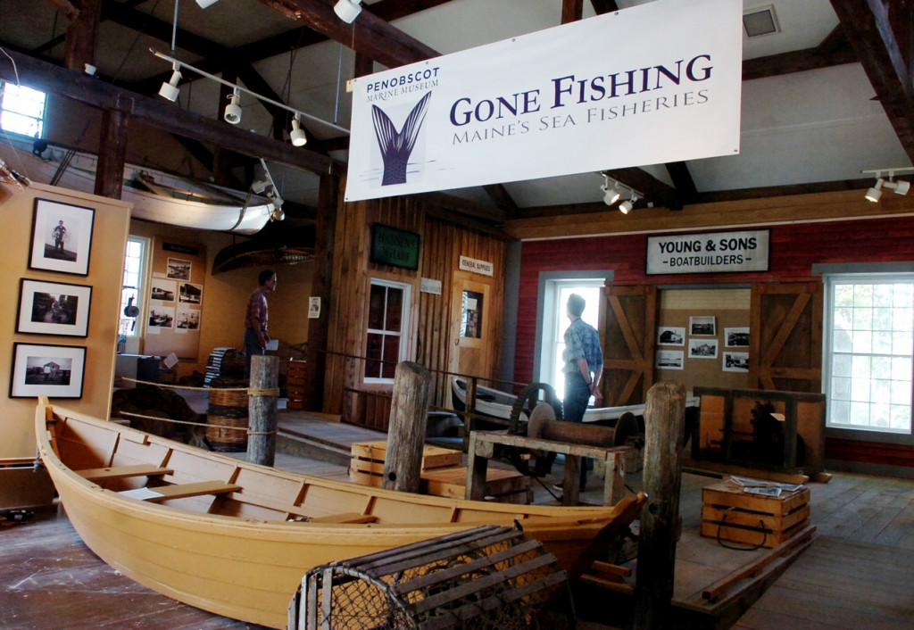 "Visitors to the Penobscot Marine Museum in Searsport walk through the museum's newest exhibit, ""Gone Fishing: Maine's Sea Fisheries,"" earlier this month. The interactive exhibit explores the historical, cultural and economic impact of Maine's fishing industries, including lobster and sardine fishing."