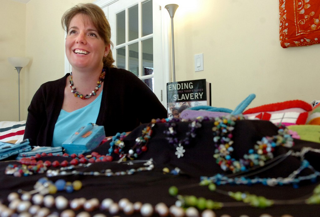 Becky Mallory of Winterport, independent ambassador for MadeBySurvivors, displays some of the unique projects which are handcrafted by survivors of human trafficking. Proceeds benefit shelters and survivors in an effort to help rebuild their lives. Buy Photo