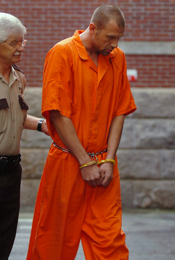 Colin Koehler, 34, of Bangor is escorted to Penobscot County Superior Court in Bangor on Thursday, August 13, 2009 for his first appearance for the murder of Holly Boutilier. (Bangor Daily News/Bridget Brown)