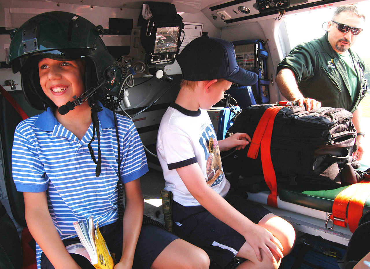 Nine-year-old Gabriel Manzo of Millinocket and his friend, 7-year-old Michael Clark of Millinocket, enjoyed touring a LifeFlight helicopter on Monday after LifeFlight helped dedicate a new landing pad at Millinocket Regional Hospital on Monday. (Bangor Daily News/Nick Sambides Jr.)