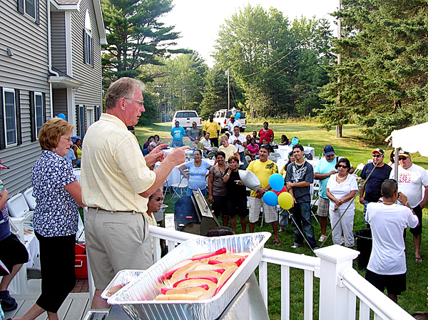 Albert and Barbara Harmon welcome the Senior League baseball team from Aruba to a cookout at their home in Hancock on Monday. The couple befriended the team and those traveling with them based on their love of the island where they visit each year. The team is in Maine to compete in the Senior League World Series which began on Saturday. (Bangor Daily News/Rich Hewitt)