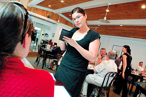 Waitress/ bartender Breanne White of Caribou takes a lunch order from Heather Nunez at Cafe Sorpreso in downtown Presque Isle. The restaurant, with its eclectic menu, has become an area favorite since it opened in November 2007.  Photographed July 7, 2009. (Bangor Daily News/John Clarke Russ)