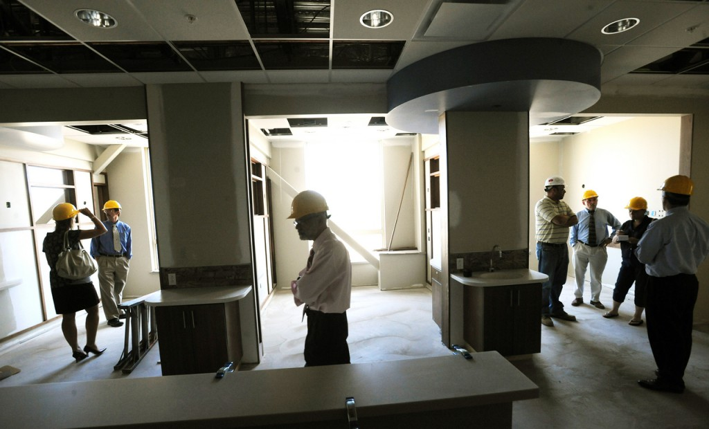 People check out some of the infusion bays at the Cancer Care of Maine new treatment facility in Brewer.  The facility is near complete and is expected to open in mid-December of this year. (Bangor Daily News/Gabor Degre)