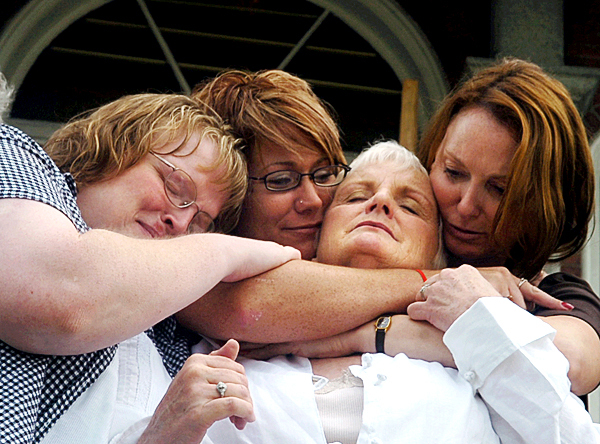 Lucille Hoxie (third from left) is hugged by daughter Lucinda Hoxie (left), Jennifer Nickerson-Steward and Candy Daniels outside the Somerset County Courthouse on Wednesday after a guilty verdict in Shannon Atwood's trial for the murder of Lucille Hoxie's daughter Cheryl Murdoch. Nickerson-Steward was assault by Atwood in 1993, and Daniels' sister Shirley Moon-Atwood was married to Atwood and remains missing since 2006.  (BANGOR DAILY NEWS PHOTO BY KATE COLLINS)