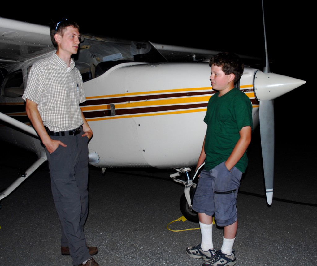 Frenchville pilot David Fernald Jr., (left) goes over some basic flight procedures with his student Cody Anderson. The two are part of a group of local flying enthusiasts hoping to form a flyers' club in the area. Anderson is working odd jobs at the Northern Aroostook Regional Airport to help fund his own flying lessons.