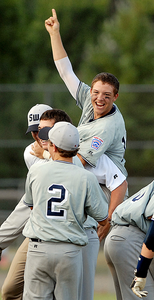 BANGOR, ME -- AUGUST 22, 2009 -- Ryan Farney and teammates from West University, Texas celebrates their 9-7 victory over Niles, California in the Senior League World Series championship game Saturday afternoon at Mansfield Stadium. PHOTO BY LINDA COAN O'KRESIK