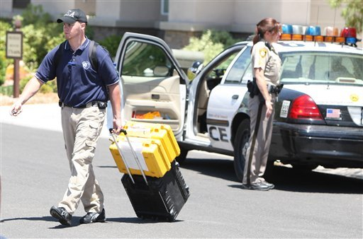 FILE- In this July 28,2009 file photo, authorities leave the scene after executing a search warrant at the Red Rock Canyon Country Club residence of Dr. Conrad Murray, in Las Vegas. The Los Angeles County coroner has ruled Michael Jackson's death a homicide. The finding makes it more likely criminal charges will be filed against Murray who was with the pop star when he died. (AP Photo/Daniel Gluskoter, File)