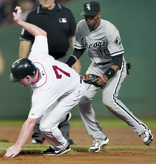 Boston Red Sox's J.D. Drew is caught in a rundown as Chicago White Sox shortstop Alexei Ramirez gets ready to make the tag during the second inning of a baseball game at Fenway Park in Boston, Monday Aug. 24, 2009. (AP Photo/Charles Krupa)