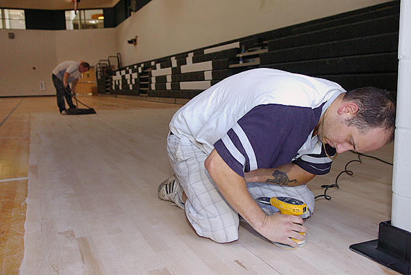 Bob Wormwood (right) and Tom Waterman (background) of New England Sports Floors put the finishing touches on the gymnasium floor at the new Mount View prekindergarten through 12th grade complex Thursday, where school begins Tuesday for Thorndike area students. In addition to a new gymnasium, the school boasts a fitness center, 315-seat performing arts auditorium and many other amenities. Buy Photo
