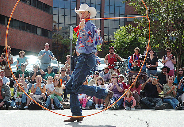Brice Chapman of Lubbock, Texas, wows the crowd with his cowboy trick-roping Sunday in the family area at the 2009 American Folk Festival on the Bangor Waterfront.Buy Photo