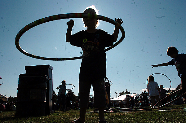 Camden Lavoie (left), 5, of Bangor Hula-Hoops along with others Sunday near the Railroad Stage at the 2009 American Folk Festival on the Bangor Waterfront. Buy Photo