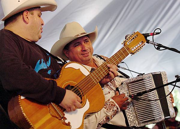 Max Baca (left) plays the bajo sexto as David Farias plays the accordion with Los Texmanias, Tex-Mex tejano power quartet, Sunday at the Dance Pavilion during the 2009 American Folk Festival on the Bangor Waterfront. Buy Photo