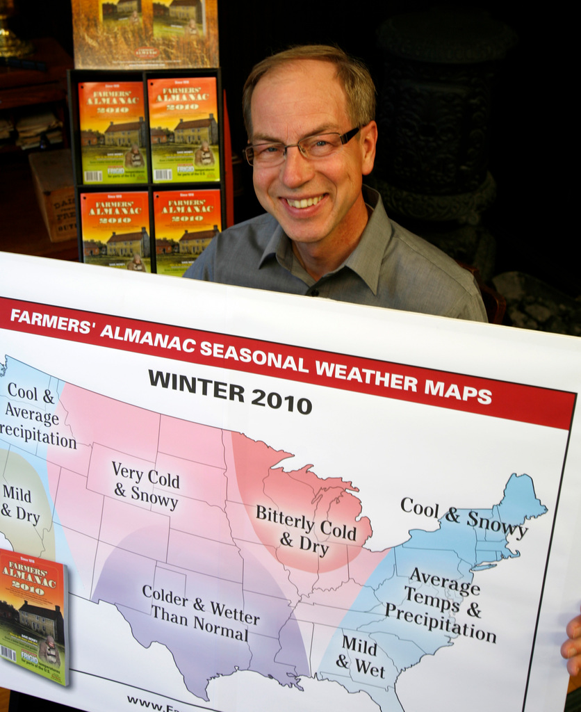 Peter Geiger, editor at the Farmers' Almanac holds up a poster that shows the company's prediction of the type of wintry weather in 2010, Friday at his office in Lewiston.