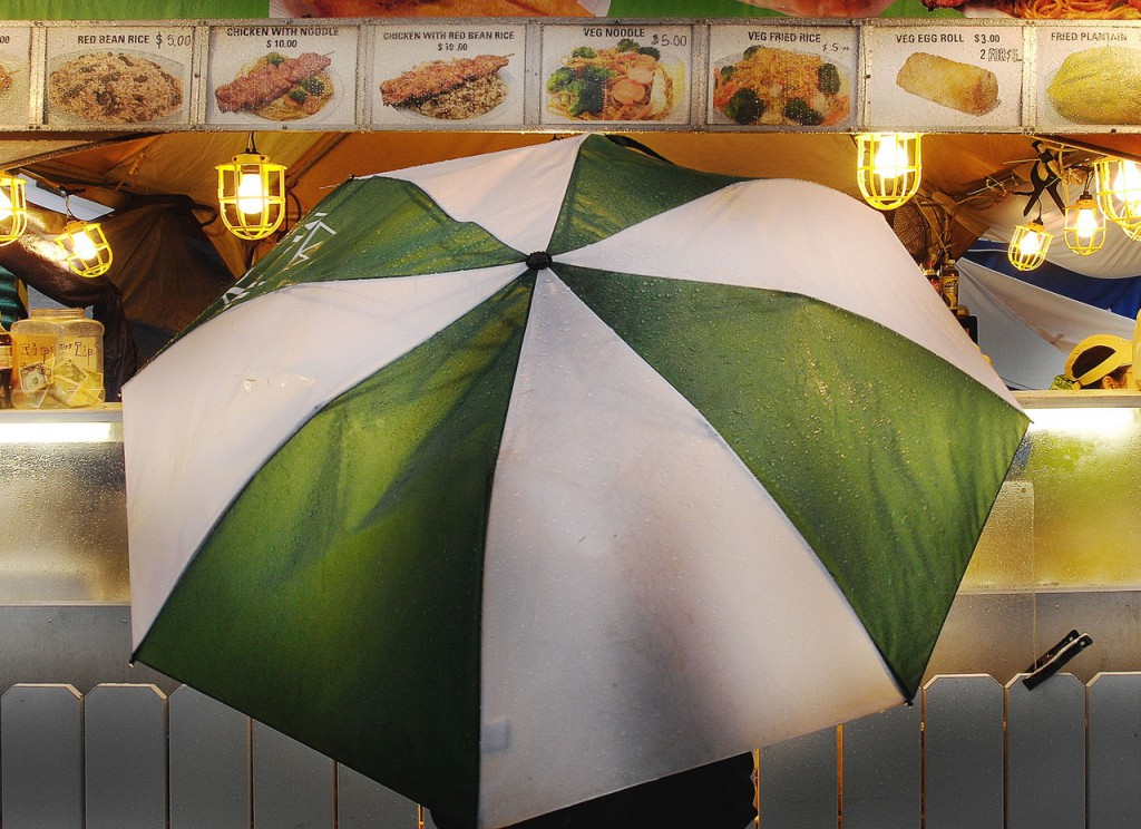 EVEN THE UMBRELLA CROWD AT THE FOLK FEST HAD TO EAT SOMETIME. tHIS ONE, SOAKED WITH RAIN, VISITED THE SIRI GRILL FOR SOMETHING HOT SATURDAY NIGHT, AUGUST 29, 2009. BANGOR DAILY NEWS/MICHAEL C. YORK