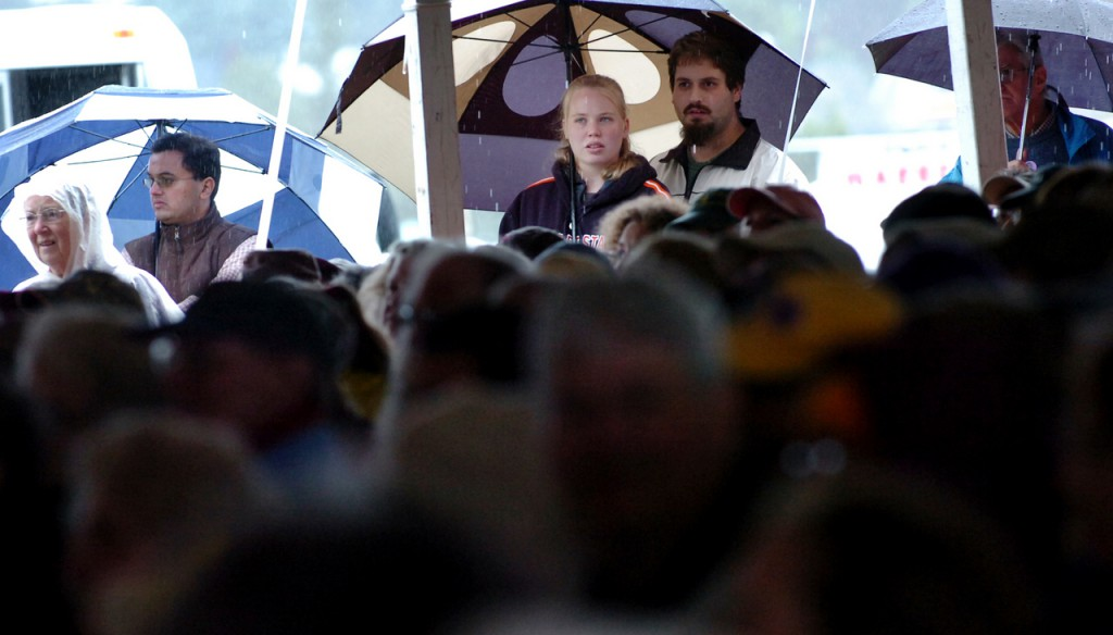 Despite the rain, seats filled up and it was standing room only for Les Charbonniers de L'Enfer, a Quebecois a capella group, at the Penobscot Stage on Saturday, Aug. 29, 2009 at the American Folk Festival on the Bangor Waterfront. (Bangor Daily News/Bridget Brown)