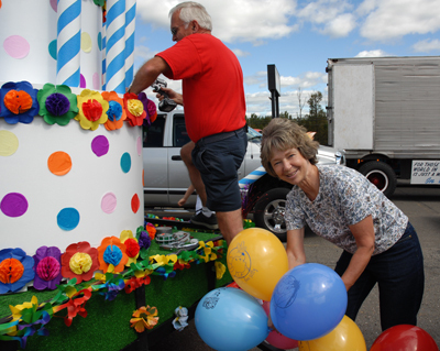 Jim and Nancy Chandler work together putting the finishing touches on their float from the Caribou Children's Discovery Museum entered in the Caribou 150th celebration parade on Saturday. &quotWe are building awareness of the museum,&quot Nancy Chandler, president, said. &quotIt shows what creative fun we will have in the future.&quot Buy Photo