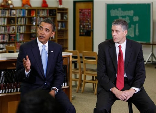 President Barack Obama, accompanied by Education Secretary Arne Duncan, talks to students prior to delivering a speech on education at Wakefield High School in Arlington, Va., Tuesday, Sept. 8, 2009. (AP Photo/Gerald Herbert)