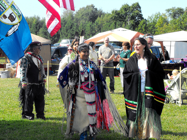 Maliseets and other Native Americans dance in the sacred circle in traditional attire during the Houlton Band of Maliseet Indians 29th annual Recognition Day Celebration. The Houlton Band of Maliseet Indians has been federally recognized as a government by the U.S. since October 1980.  Each year during the Recognition Day celebration, Maliseets gather on tribal lands for a fete that includes a sacred fire, dancing, singing, drumming and a traditional feast. (BANGOR DAILY NEWS PHOTO BY JEN LYNDS)
