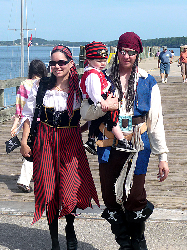 Tinia Graham, Joseph Graham and 20-month old Jackson Graham of Argyle, came to Eastport in costume Saturday for the annual Pirate Festival. Hundreds of people turned out for games, bed races, plane and boat rides, vendors and dancing. BANGOR DAILY NEWS PHOTO BY SHARON KILEY MACK