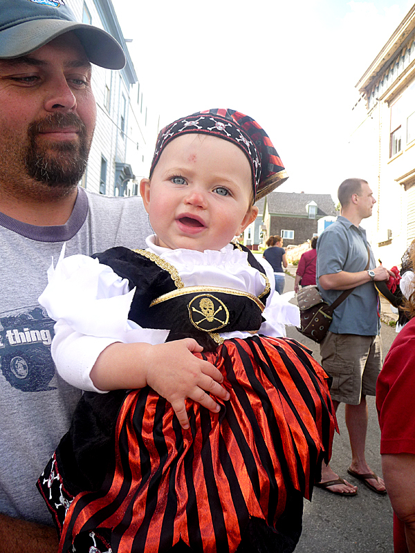 Mackenzie Johnson, one, of Perry, shows off her best pirate face at the Eastport Pirate Festival Saturday, along with her father, Howard Johnson. BANGOR DAILY NEWS PHOTO BY SHARON KILEY MACK