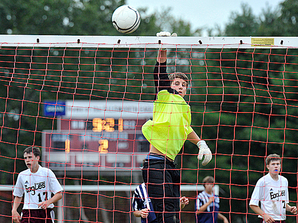 Ellsworth keeper Justin Carter deflects a shot over the crossbar in the second half to preserve a 1-1 tie in their game versus Presque Isle, Saturday, Sept. 12, 2009. BANGOR DAILY NEWS PHOTO BY MICHAEL C. YORK
